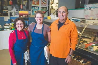 Carbonaro, Lendway and Voto stand in the store