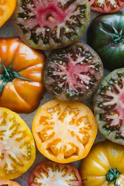 To photograph these juicy heirloom tomatoes, I cut them in half