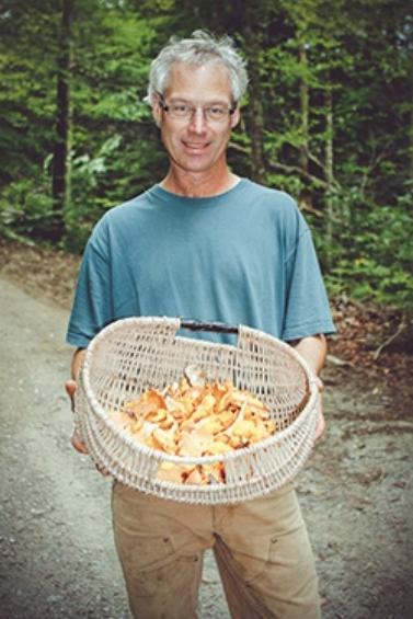 Cranberry Bob holding Vermont mushrooms