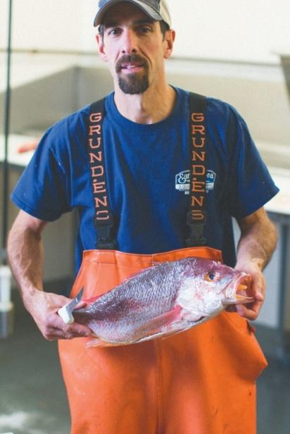 Greg Bishop holds fish