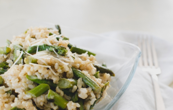 This simple asparagus dish is bright with citrus notes from the lemon zest and juice as well as a subtle nuttiness from the brown rice and Parmigiano-Reggiano cheese.