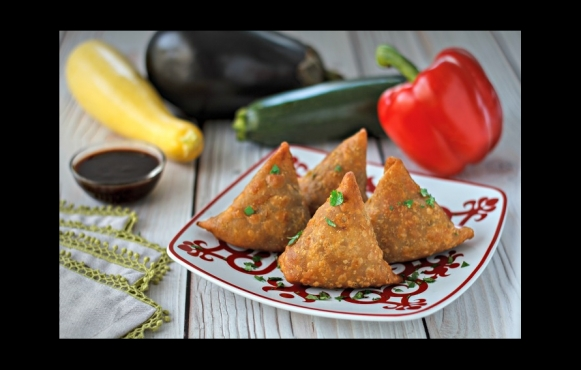 Embrace the aromatic flavors of India with this delectable recipe for samosas from the Woodstock Farmers' Market.